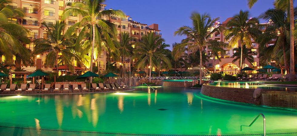 villa-del-palmar-flamingos-pool-by-night